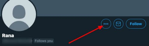 click on three dots near follow button on twitter
